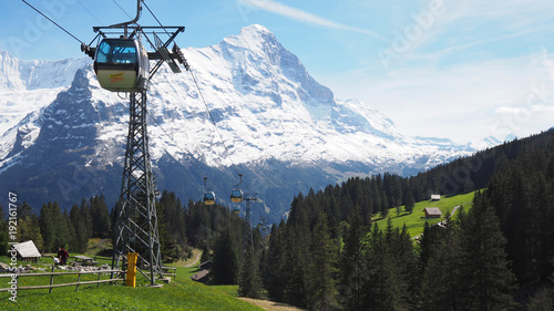 Foto op Canvas Blauwe hemel View of cable car to Grindelwald First with Alps mountains in the background, Grindelwald, Switzerland May 2017