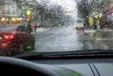 view of the road in the city, through the windshield with drops of water, during the rain - 192169701