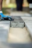 Manual worker installing paving block - 192172524