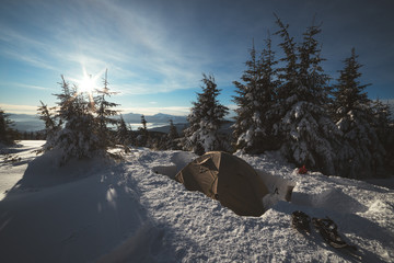 Frozen tents in the high mountain on winter time. Carpathian mountains, Ukraine, Europe. Landscape photography