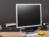 dirty monitor,keyboard,charger for the battery - 192177567