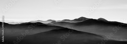 Mountain landscape in sutton, black and white with mist on background - 192180956