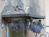 A lot of hanging bouquets of lavender on  the porch roof in Provence city, France - 192190372