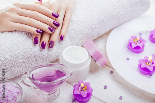 Staande foto Manicure Beautiful purple manicure with spa essentials