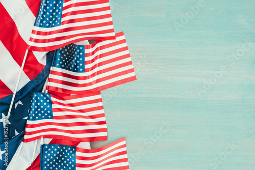 top view of arranged american flags on blue wooden tabletop, presidents day concept