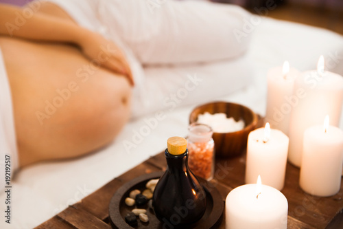 Young pregnant woman relaxing at Spa salon, Spa treatment