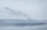 Clouds and fog over a snow covered plateau in the mountains. Vercors, France. - 192199740