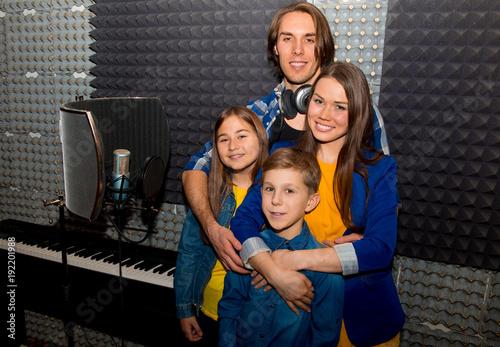 Family in a recording studio