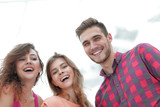 closeup of three young people smiling on white background - 192204726