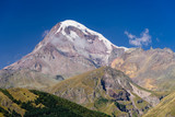 Mount Kazbegi is a popular natural attraction near Stepantsminda (Kazbegi) village, Georgia