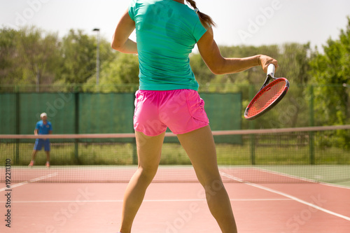 Fotobehang Tennis Girl playing with a racket in tennis on the court