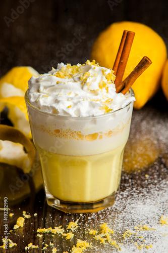 Fotobehang Milkshake smoothie with tropical fruits. Orange smoothie on rustic background.