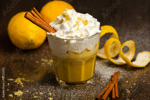 Foto op Aluminium Milkshake smoothie with tropical fruits. Orange smoothie on rustic background.