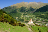 Beautiful natural landscape. Church and green meadows. The mountains in the background. The village of Mestia, Svaneti, Georgia.