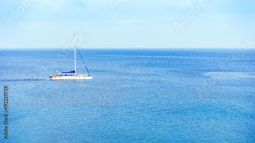 In de dag Cyprus A sailing yacht sails in middle of sea