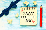 Happy Father's Day inscription on wooden background