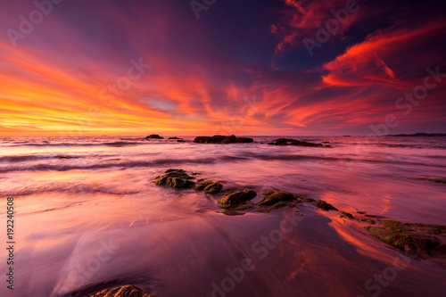 Foto op Aluminium Zee zonsondergang burning sky during sunset at Kudat beach, Malaysia.
