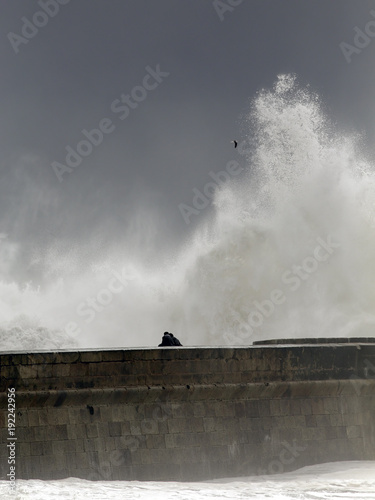 Foto Murales People watching a storm on a dangerous sea pier
