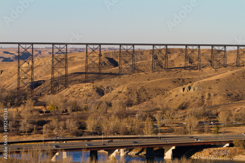 Rail bridge through the prairie landscape