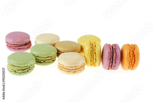 Colorful macarons isolated on the white background Poster