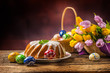 Easter Cake. Traditional ring marble cake withe easter decotation. Easter eggs and spring tulips. - 192264902