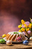 Easter Cake. Traditional ring marble cake withe easter decotation. Easter eggs and spring tulips. - 192264906