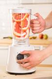 Grapefruit white Blender on a wooden table.