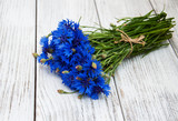blue cornflowers on a table