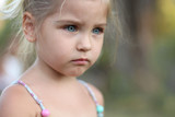 Portrait of a gloomy offended child. Without a smile. - 192289576