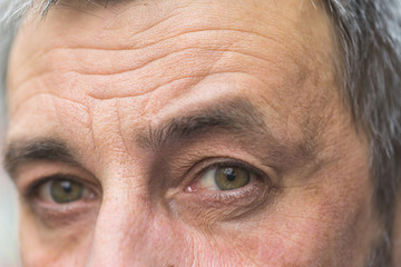 Detail of middle aged man eyes