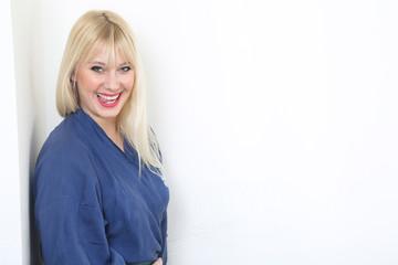Blond caucasian woman dressed in blue kimono