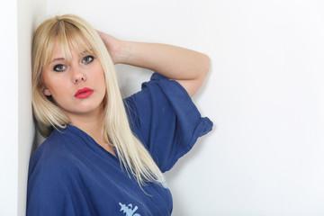 Portrait of blond caucasian woman dressed in blue kimono