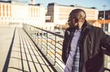 Elegant black man in sunlight on street - 192293158