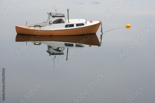 Aluminium Bleke violet yellow boat reflected on a fjord in Ringstad at Lofoten Island in Norway
