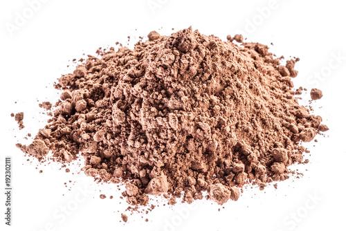 Cocоa powder or carob powder on white background.