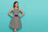 Beautiful Young Woman In Black And White Striped Dress Is Looking Away - 192308191