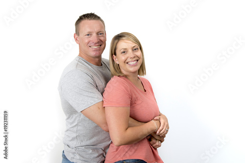 Foto Murales young attractive happy couple in love looking sweet and cheerful in wife and husband or girlfriend and boyfriend successful relationship concept