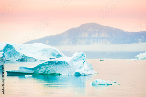 Big blue icebergs in Saqqaq village at sunset, western Greenland - 192314330