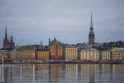 Landmarks an houses at the island Riddarholmen at the lake Malaren in Stockhlom a cold winter morning