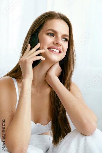 Beautiful Woman Talking On Phone Indoors.