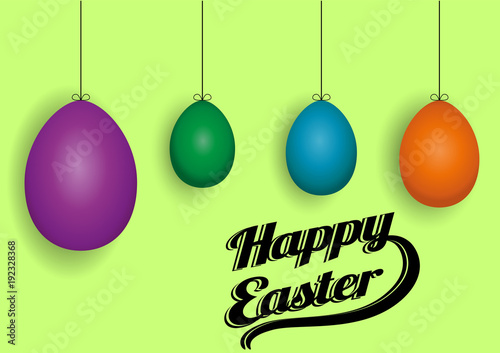 Colored Easter eggs on a green background