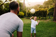 Quadro Father and son playing with a football