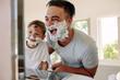 Quadro Happy father and son having fun while shaving