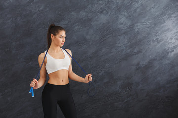 Athletic woman with skipping rope © Prostock-studio