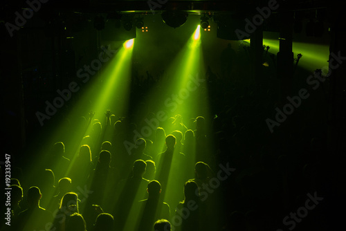 Foto op Canvas UFO Rock concert crowd people in front of the bright stage lights