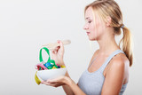 Diet. Girl with colorful measuring tapes in bowl - 192346102