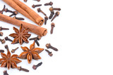 Cinnamon sticks with star anise and cloves on white background - 192347388