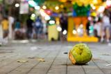 A coconut on the street after carnival celebration, Brazil. - 192360540