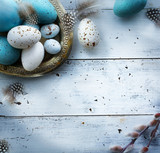 Easter background with Easter eggs on white table - 192362385