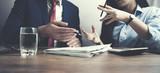 Team members discussing data at meeting - 192373176